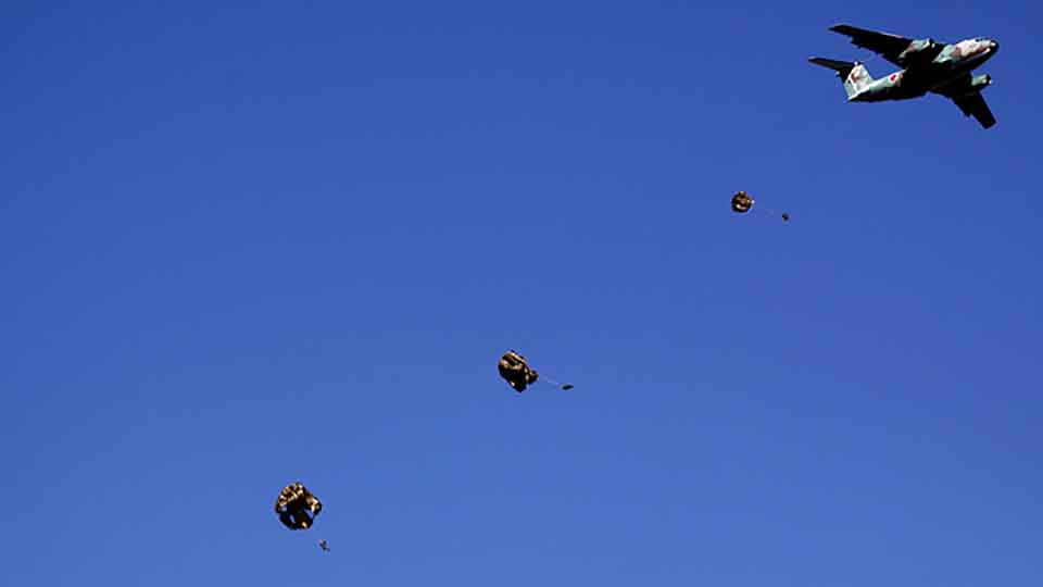 Troops from the Japan's Ground Self-Defense Force 1st Airborne Brigade dive from a C-1 transport plane during an annual new year military exercise in Narashino, east of Tokyo January 11, 2009.