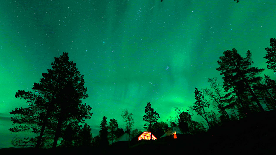 Our World : An Aurora Borealis (Northern Lights) is seen over a mountain camp north of the Arctic Circle, near the village of Mestervik late September 30, 2014.