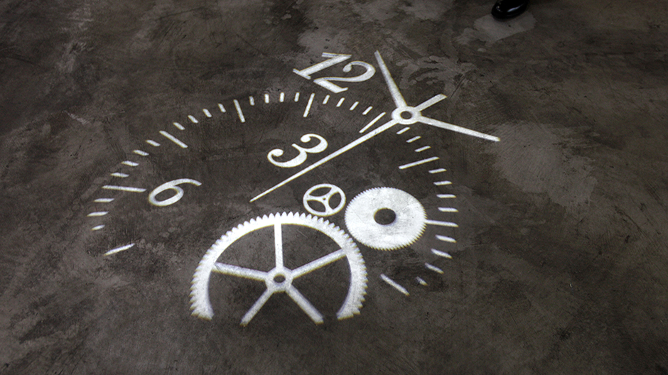 A clock is projected onto the floor at the Hong Kong Watch & Clock Fair September 2, 2009.